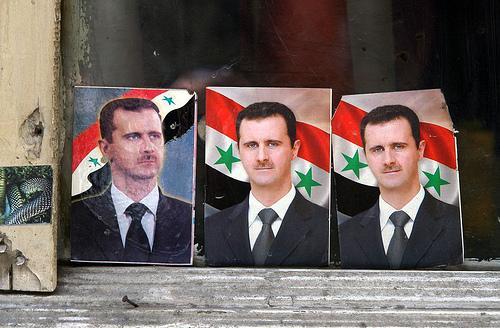 Portraits of Syrian President Bashar al-Assad.