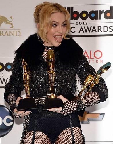 Post ceremony, Madonna shows off her awards.  Madonna won for top touring artist, top dance artist, and top dance album. Photograph by Karen Blue, available under a Creative Commons Attribution and Share Alike license. Copyright © 2013 Karen Blue.
