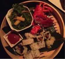 Ninja New York offers an unforgettable dining experience. This meal included sushi, japanese salad, and lobster.
