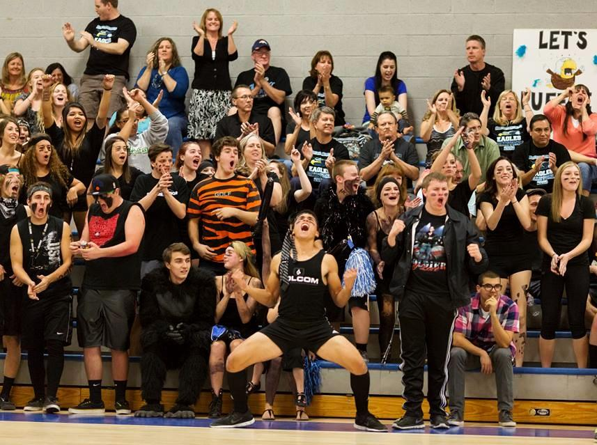 Horizon+Honors+students+and+alumni+celebrate+as++the+varsity+volleyball+team+scores+a+point.+In+the+center+is+senior+Connor+Pendleton%2C+who+was+voted+Most+School+Spirited+by+his+fellow+classmates.