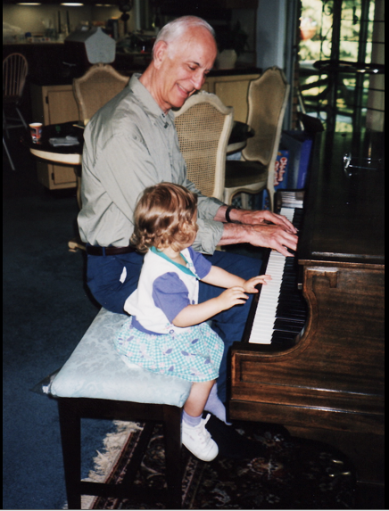 Junior Alexa Geidel sits with her grandfather at the piano.  The loss of her hero inspired a reflection of what mourning means along with the crucial role tradition plays in a family.
