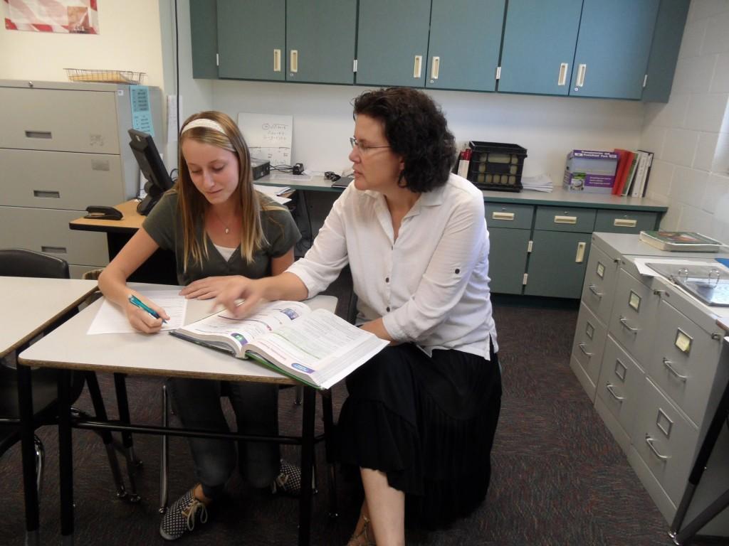 Mrs.+Patterson+helps+eighth+grader+Emily+LaBatt+with+her+math+homework.
