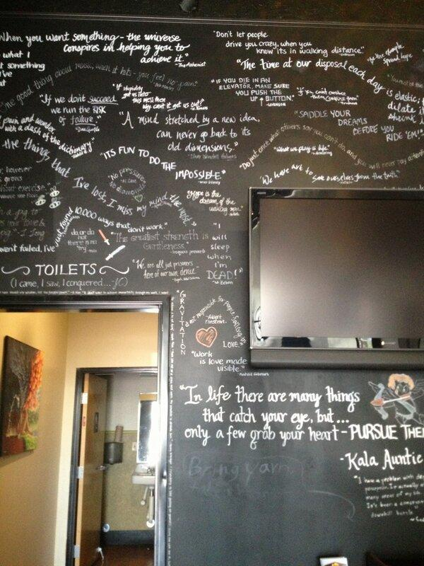 The quote wall located in the back of the cafe. It features quotes from inspirational figures such as Aristotle and Yoda.