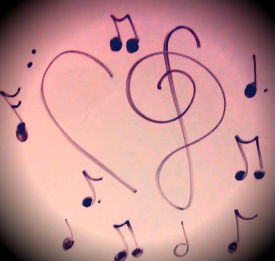 A bass and treble clef formed into a heart. Music is expressed in many forms.