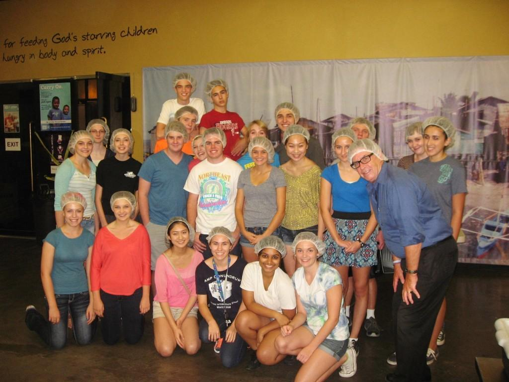 National Honor Society gathers for a picture after volunteering at Feed My Starving Children in its Tempe location. There are seven permanent locations throughout the United States.