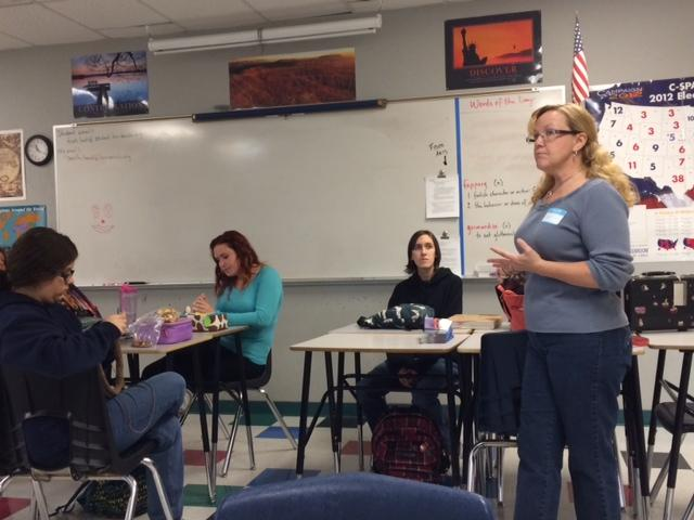 Gail Engstrom from the Phoenix Rescue Mission speaks to students about the impact of their project. Engstrom came to the Fiber Arts meeting on Nov. 26.