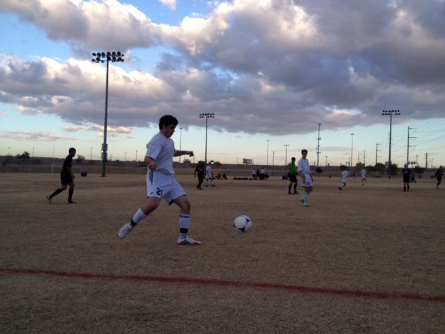 Junior Lucas Iosue readies to clear the ball.
