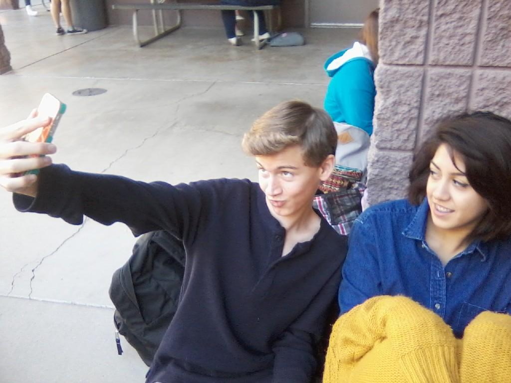 Freshman Zane Greenawalt takes a selfie with freshman Mykah Hernandez during lunch. Selfies have become a large part of people's daily lives.