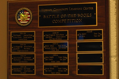 This is the Battle of the Books plaque, found in the media center. The names of the winners are posted on it from  the first time the Battle of the Books was held.