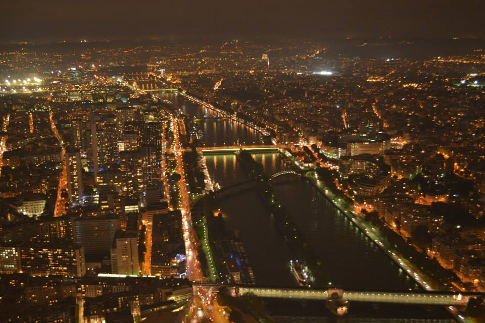 The+view+of+Paris+at+night+from+atop+the+Eiffel+Tower.
