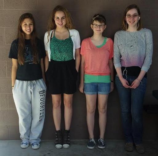 Four cute Horizonites pose against the wall; (left to right) senior Lauren Arenas, junior Alexa Geidel, seventh grader Addison Bennett, and senior Katy Abbe.