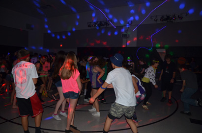 The Slam Jam Space Jam was fun for all who attended. The laser beam lights, smoke machine, and neon colors made it exciting for friends to be together listen to their favorite songs.