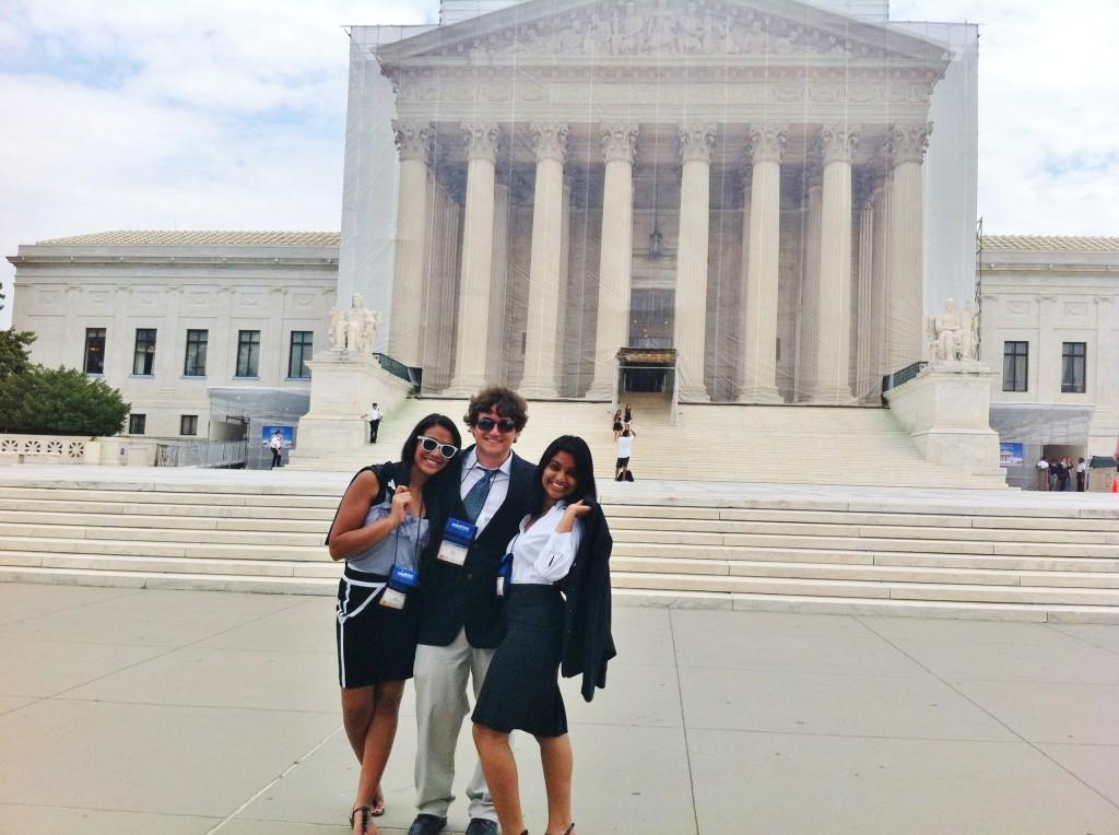 During the Washington Workshops Congressional Seminar, students were released to spend one of their mornings on Capitol Hill, visiting representatives and senators and exploring the area. These three students pose in front of the Supreme Court Building, celebrating the fact that DOMA was repealed only hours before.