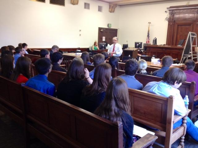 The Honorable Dean Fink speaks to students about the case and his role as a judge during the lunch recess. Students were able to see what they have been learning about firsthand in the courtroom.