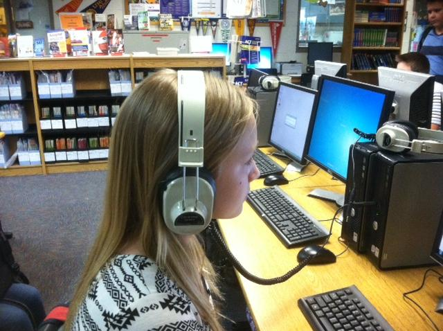 Anna+Cochrane+listens+to+an+audiobook+in+the+media+center.%0D%0AStudents+have+the+option+of+listening+to+books+online.