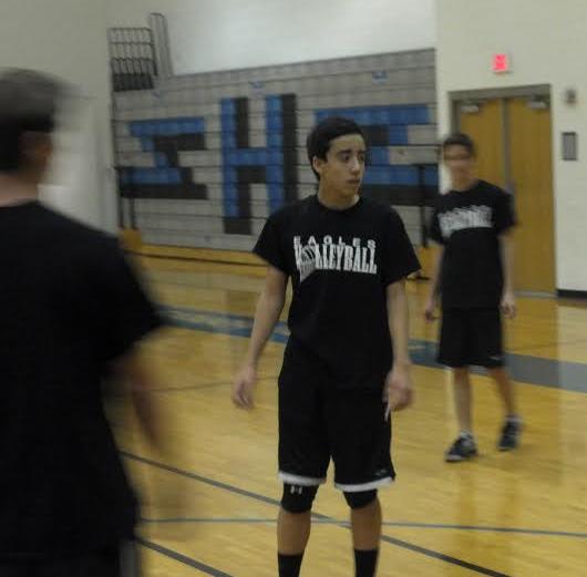 Aaron Tam and teammates practice after school.