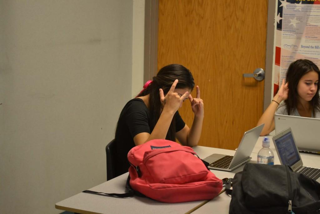 Seniors Alicia Stewart and Alex Costabile work hard in AP Government after the AP exam is over.