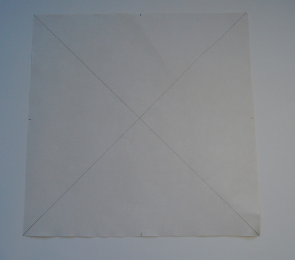 1) Cut the paper into an 8x8 square. Mark the center of the square with a dot. Seperate the paper into four squares diagonally by marking it with a pencil.
