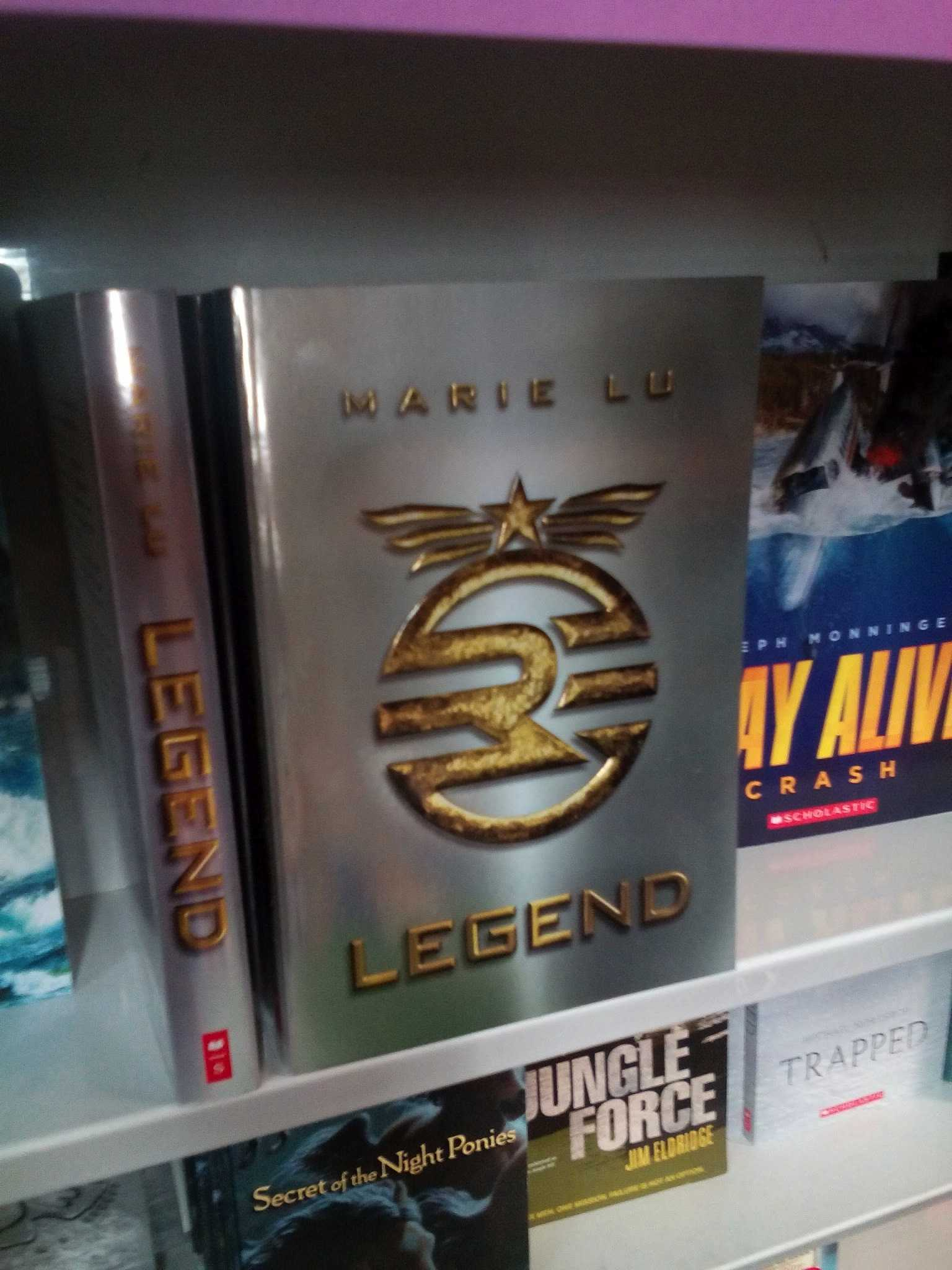 """Legend"" is available at the Scholastic Book Fair, running from May 12 to May 15. Marie Lu published this novel in 2011."