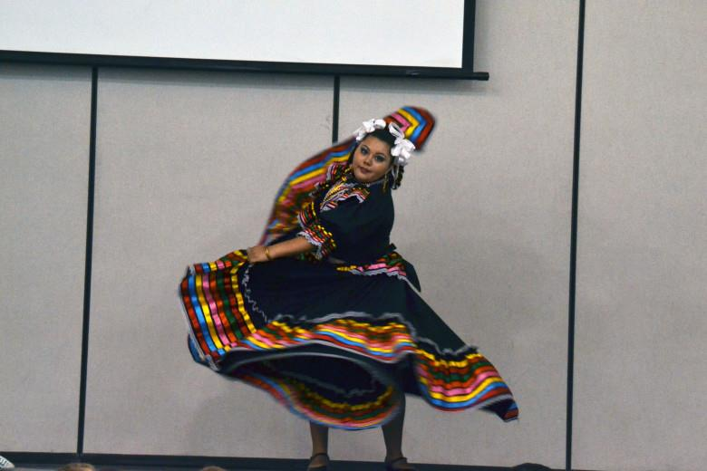 Andrea Villalobos performs the traditional folklorico Jarabe Tapatio dance for elementary students on Cinco De Mayo. The Villalobos ladies are seasoned members of the dance team, Cualquati Folklorico, in Maricopa.