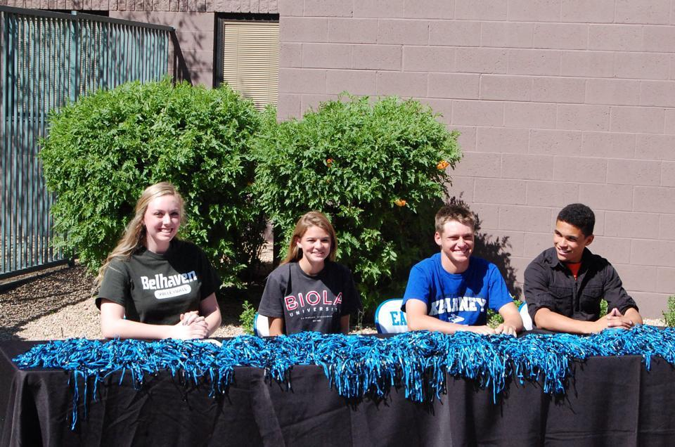From left to right: Seniors Blaykleigh Smythe, Mikaela Martin, Chris Senna, and Connor Pendleton pose for a picture during their signing ceremony.