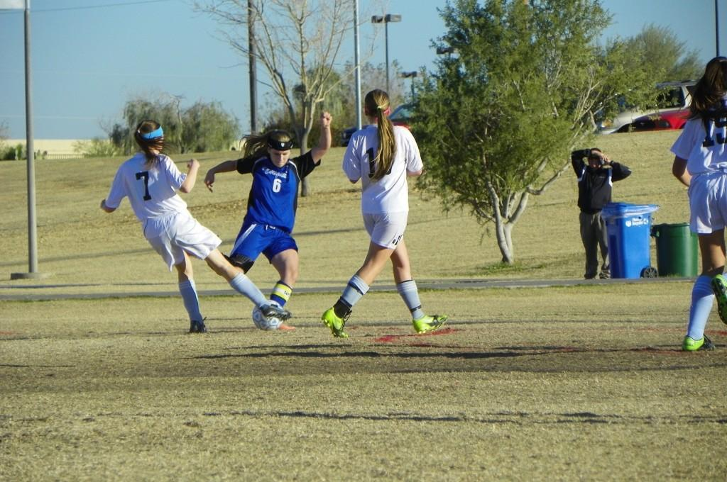 In the girls' soccer game between Valley Christian and Horizon Honors, a defender from Valley Christian faces off against two Horizon Honors athlete. Horizon Honors lost the game by one point.