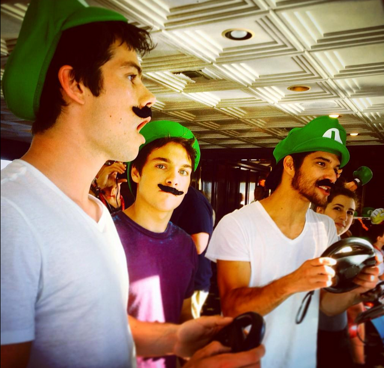 (L to R) Stars O'Brien, Sprayberry, and Posey play video games in the Nintendo Lounge at San Diego Comic Con. Producer Davis announced the renewal of the show at SDCC on Thursday.