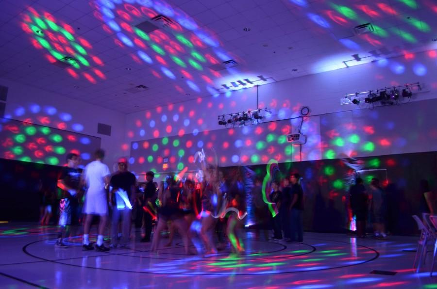 Students have a great time at the Blackout Dance socializing and dancing.