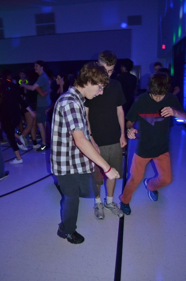 Sophomore's Kyle Rosser and Isaac Elkins show off their moves at the dance.