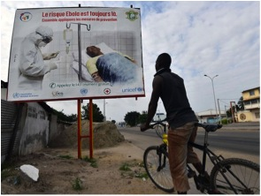 Things haven't taken a turn for the better yet in the regions flanked by Ebola, but the amount of hyper-awareness has skyrocketed. Here, a man in the Ivory Coast reads a PSA cautioning citizens of the virus; his homeland shares a border with two of the infected nations.