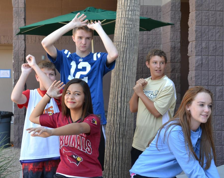 Students sporting their sport gear of their choice, pose for their respective sports. Mondays spirit week theme was Sports Day.