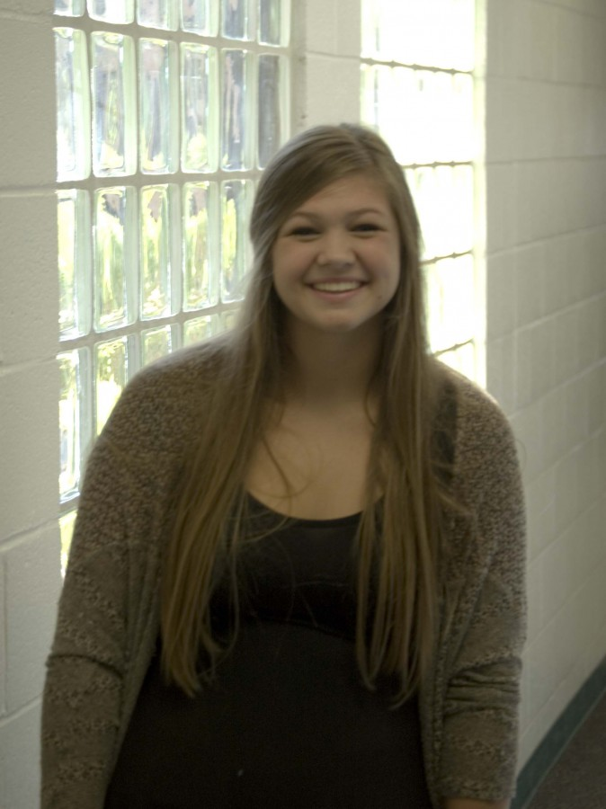 Emma Martin poses for a picture. Martin is a swing player for the Horizon Honors Volleyball team.