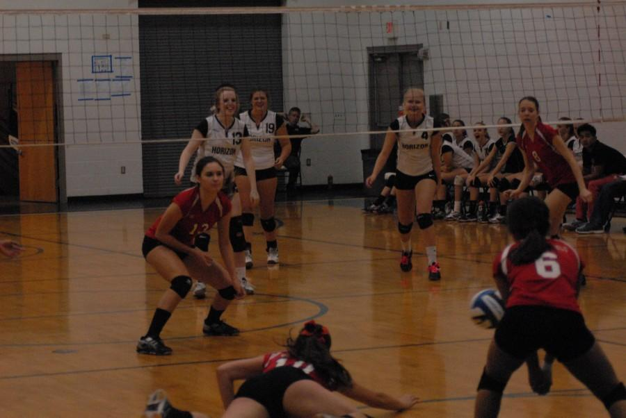 JV Volleyball players from the opposing team dive to save the ball. Horizons JV teams beat Williams field in two matches.