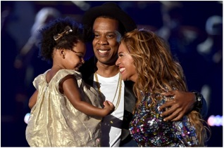 Beyoncé with husband Jay-Z and daughter Blue Ivy. The family came into a group hug after she  accepted her MJ Video Vanguard Award.
