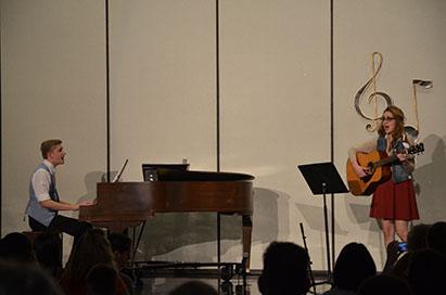"Seniors Bennett Wood and Alexa Geidel perform a scene from the musical ""Once."""