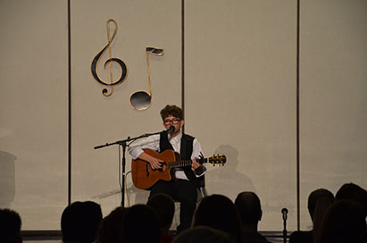 """Sophomore Joey Vitagliano rocks out in """"Kathy's Song."""""""