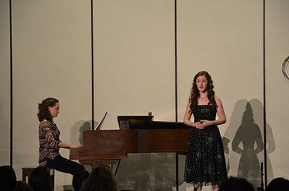 Senior Abbey Fitzgerald sings an Italian Aria while accompanied by her twin sister Brigit Fitzgerald.