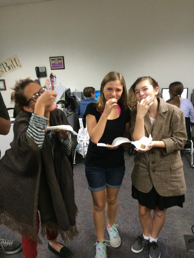Mrs. Britt and two columnists from the Journalism team enjoying some delicious fudge.