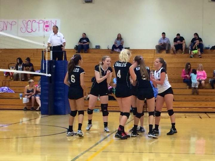 The lady Eagles bring it in for an encouraging cheer during their game against Parker.