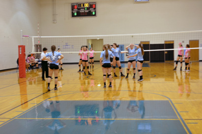 The opposing team Yuma Catholic (in pink) and Horizon Eagles in blue  set up for the last home game. The final set ended  25-23, way to go Eagles!