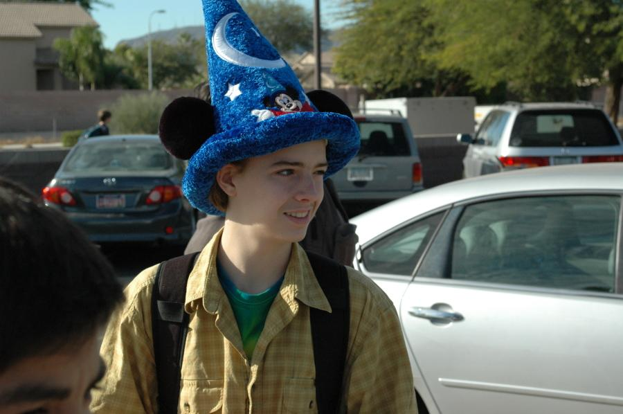 Student wearing Mickey Mouse hat. He is wearing it after school.