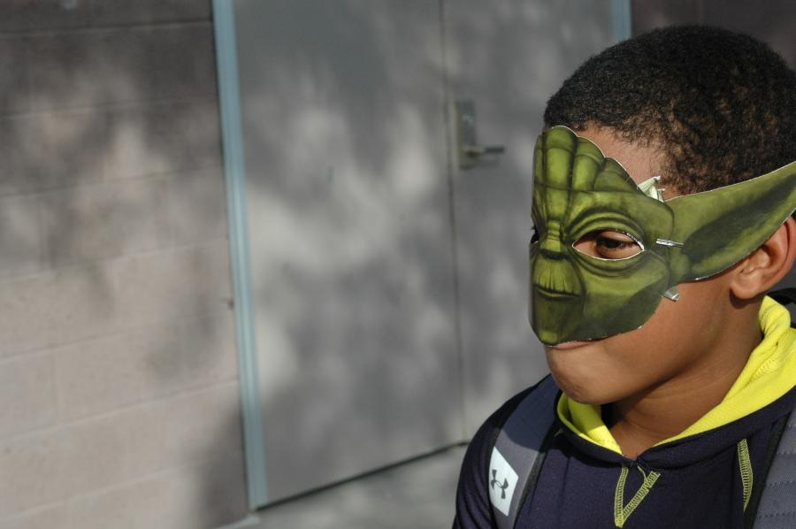 Student Rocks a sweet Yoda mask. He decided to wear it after school as well as during.