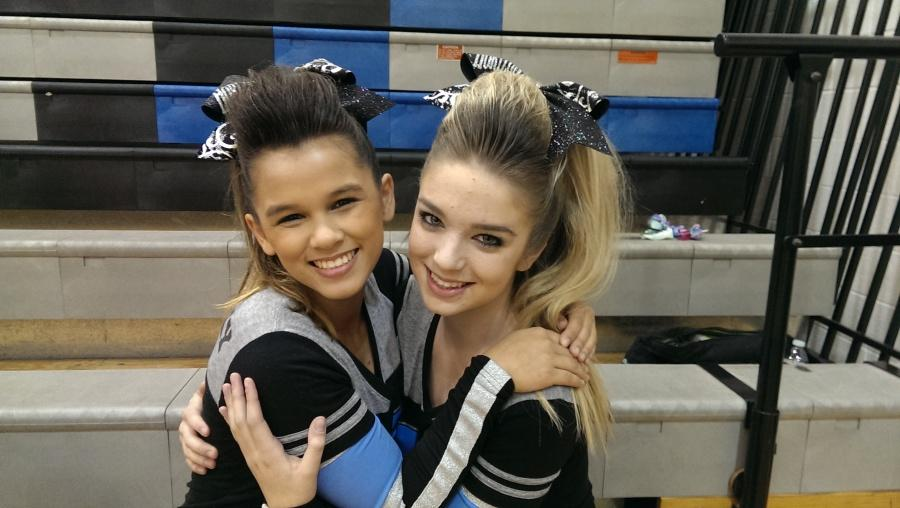 Juniors Destiny Lovely and Kai Farley pose before their departure for State Qualifiers Saturday Nov. 15.  Both girls were eager to perform and cannot wait to finish the season strong.