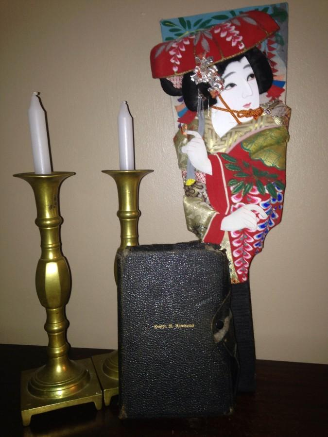 My family's Shabbat candles, my great-grandmother's Bible, and one of our many Japanese decorations stand by each other. Not many families own all three of these things.