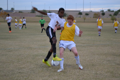 Senior Shawn Dixon scrambles to take a ball from Maricopa.