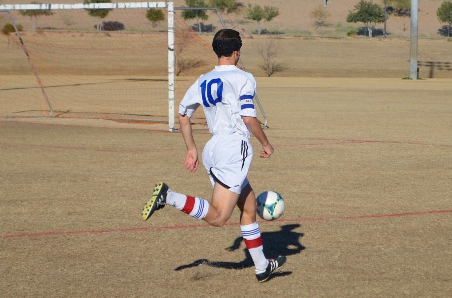 Horizon Varsity Soccer Jr. Captain Josh Drapkin (Junior) takes the ball up the line to attempt a goal.