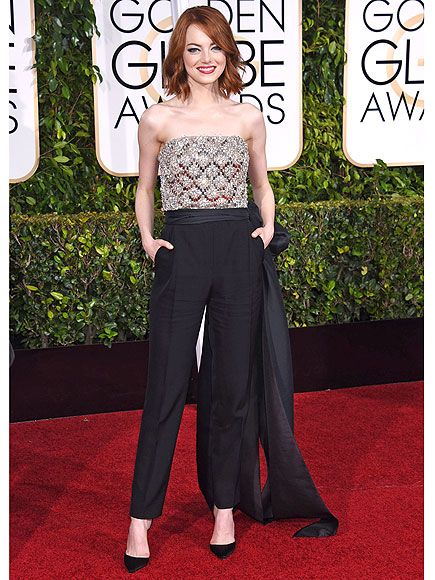 Emma Stone (in Lanvin): The flame-haired starlet never disappoints on the appropriately-matching red carpet, but this Golden Globes-worthy playsuit is one for the ages. Not only does she know her way around a fabulous gown, Stone has proven that she can even rock a playsuit on the red carpet. Granted, she did have expert assistance from Lanvin, but the juxtaposition of sparkly and matte fabrics and larger-than-life bows demand attention.