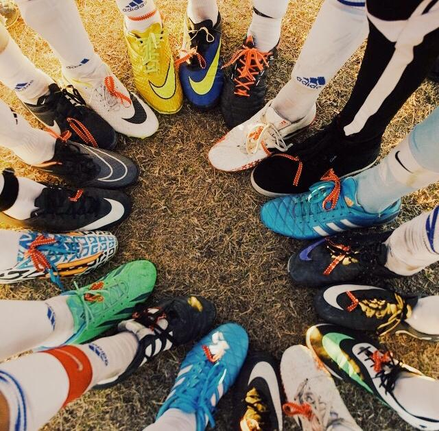 The players wore red ribbon on their cleats to honor the loss of one of the Bongard family members.