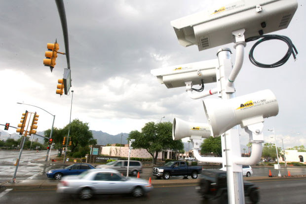 Photo radar cameras, like this one in Tucson, Arizona, cold soon be a thing of the past, as could texting and driving.