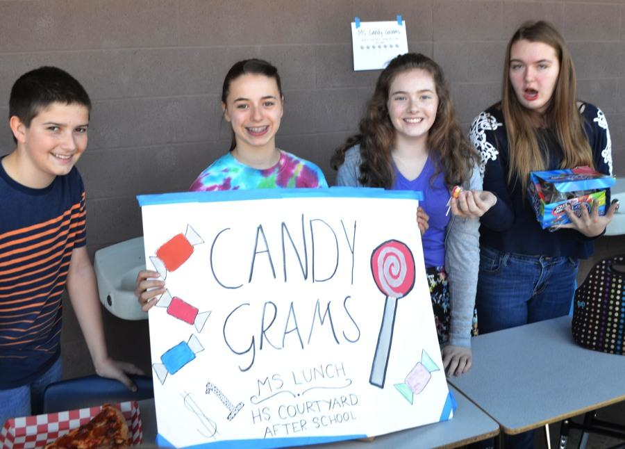Members of MS STUCO help sell candy grams. STUCO are selling these at lunch for one dollar.